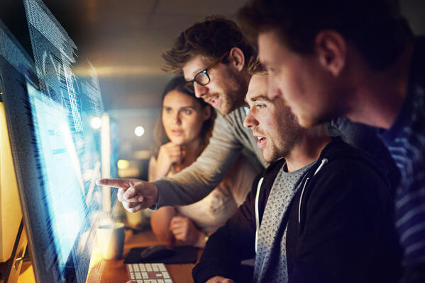 Team coding on computer - JConnelly Blog  - How to Avoid a Tech Innovation Launch Fail