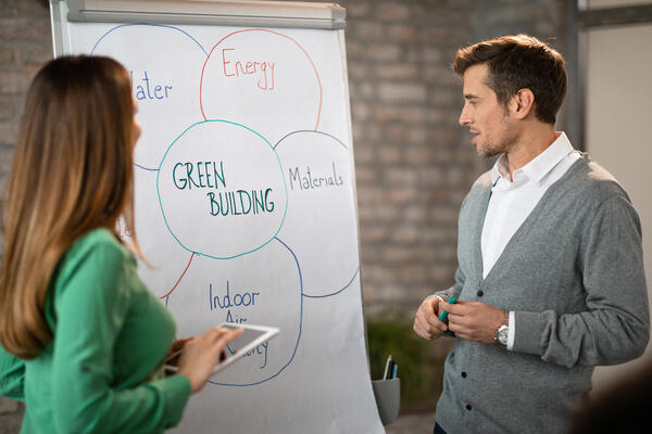 Man and woman brainstorming green building