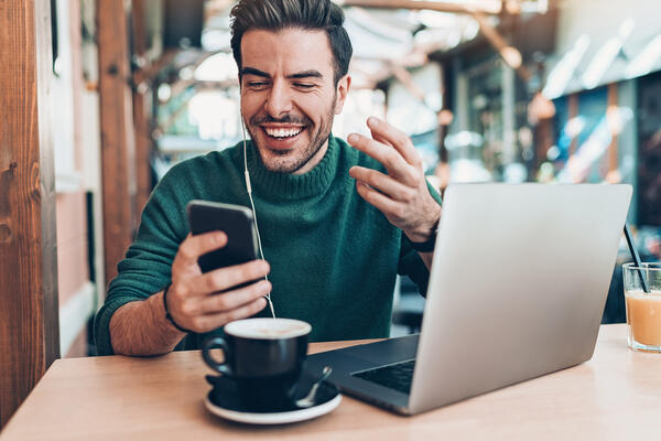 man looking at his smartphone - JConnelly Blog- CRISIS How to Navigate the Darker Side of Twitter