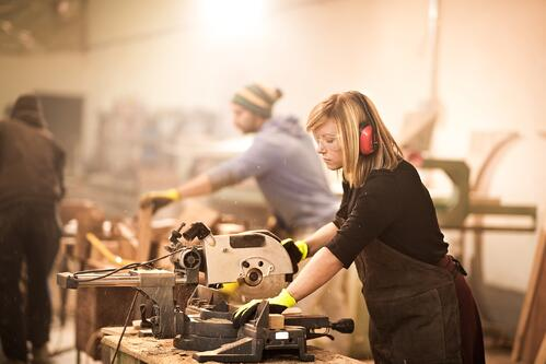 Woman working with power tools- JConnelly blog- he, she or they