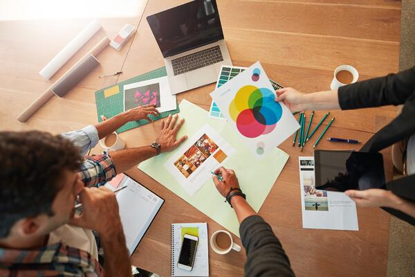 Employees looking at color palette- Why You Need Brand standards