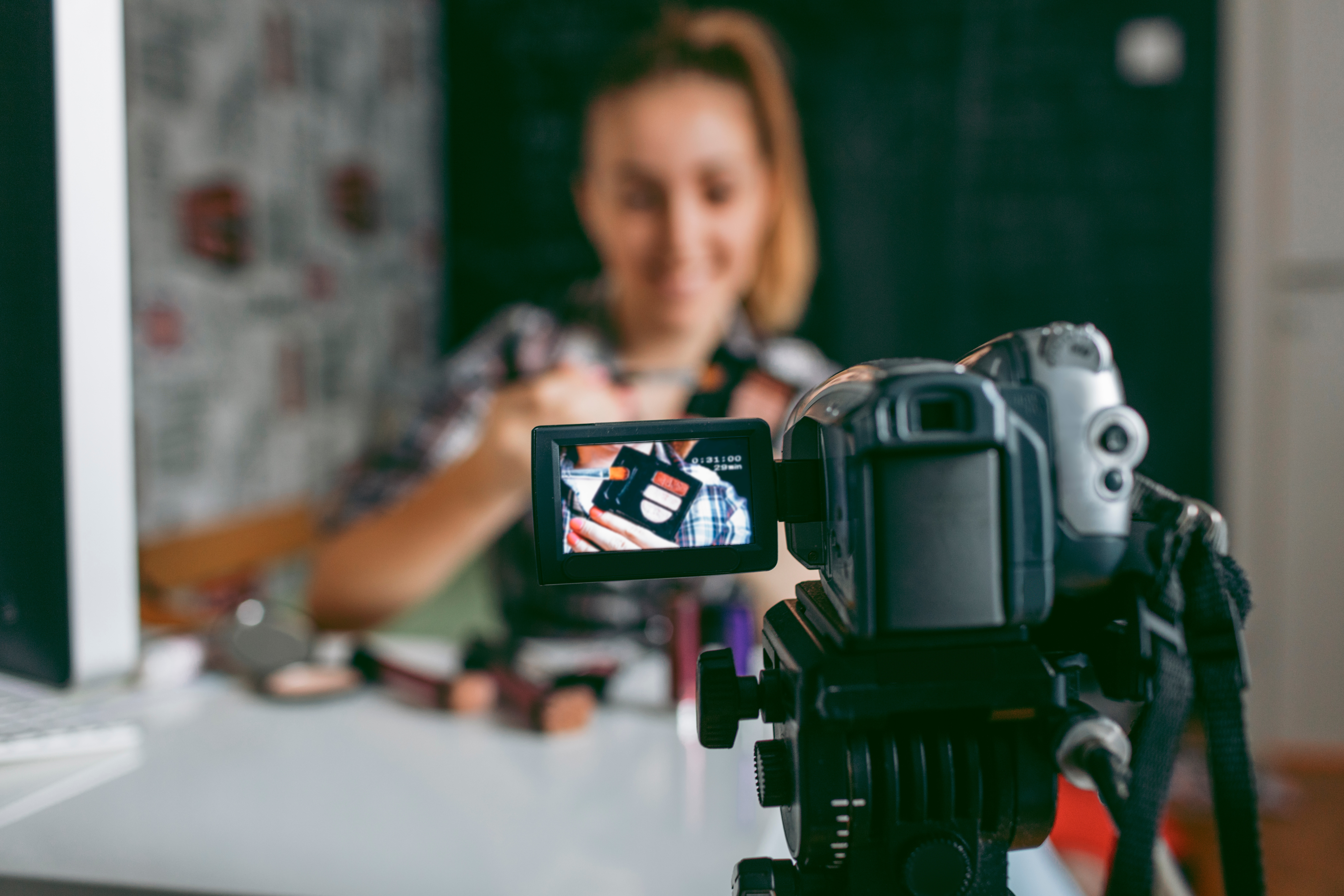 woman in front of camera- JConnelly blog- Encourage more social shares with video storytelling.jpg