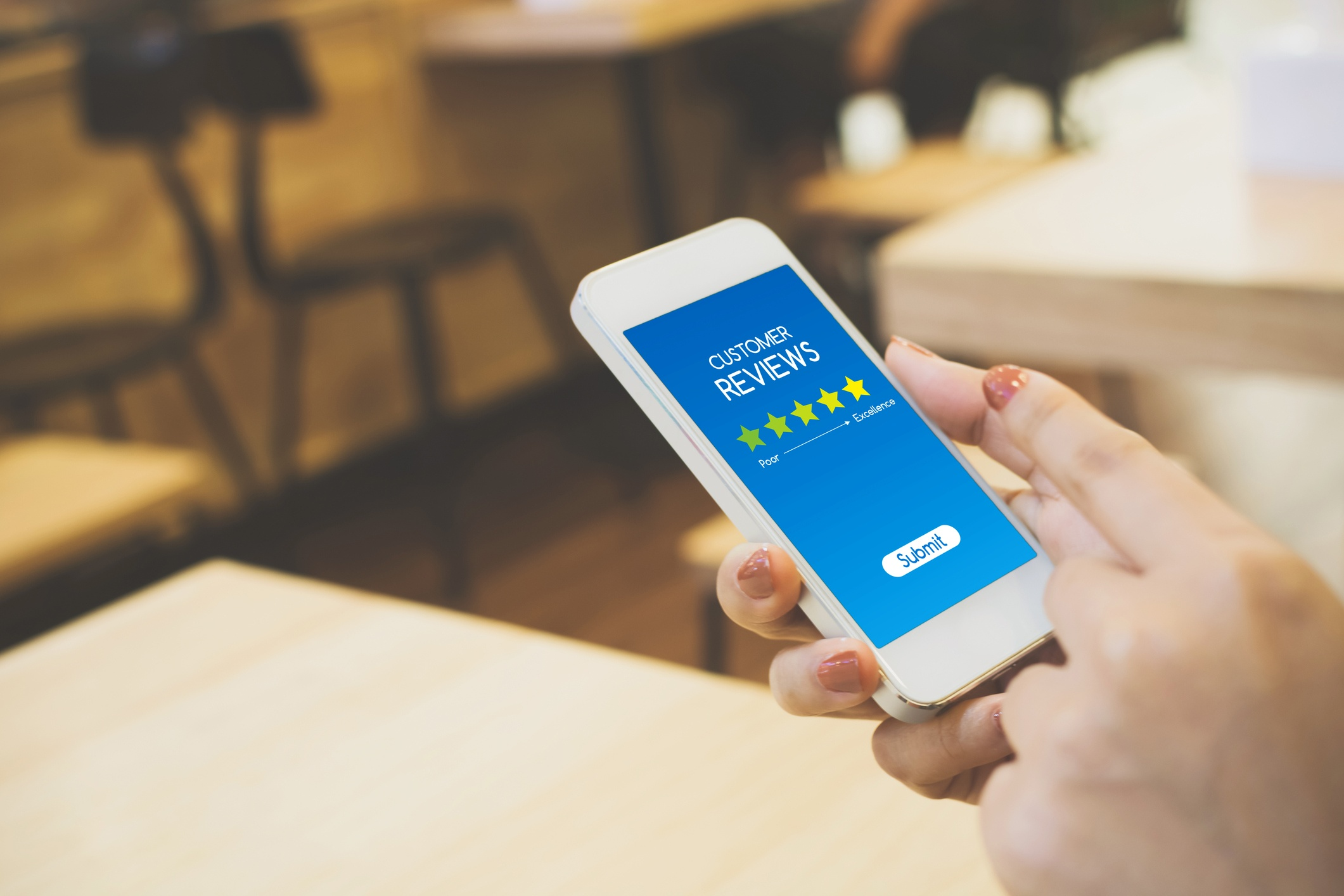 Woman on cellphone- JConnelly blog- Tips for Dealing with Negative Reviews