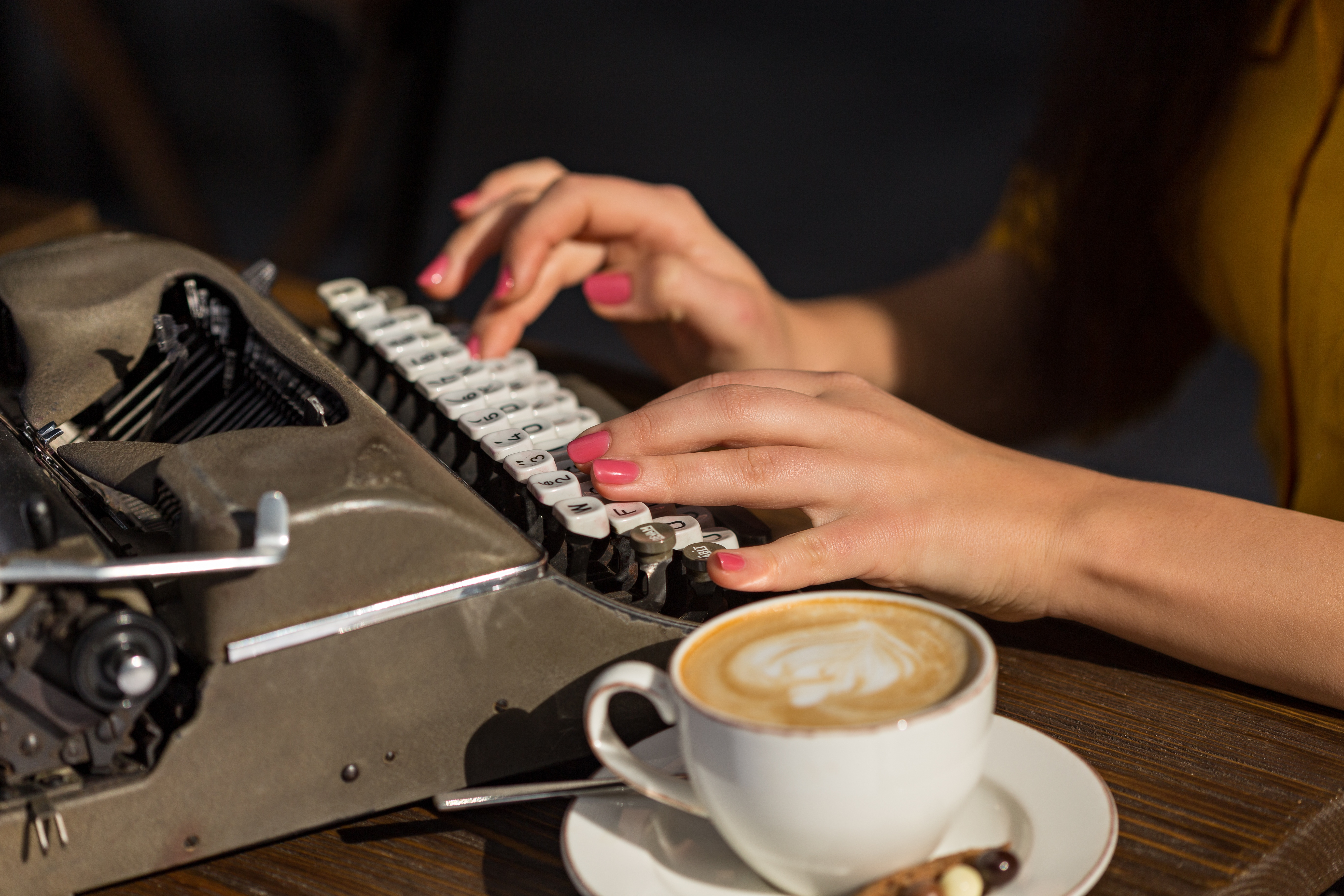 Woman typing on typewriter- JConnelly blog- Two Space, Or Not Two Space