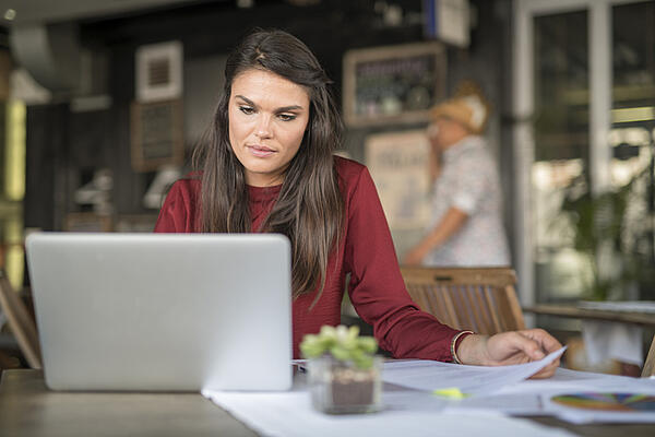 woman working on computer - JConnelly Blog - Navigating through work relationships, especially outsourced ones like ghostwriters, can be tough territory. In fact, your relationship with a ghostwriter may be unlike any other work relationship you've had.