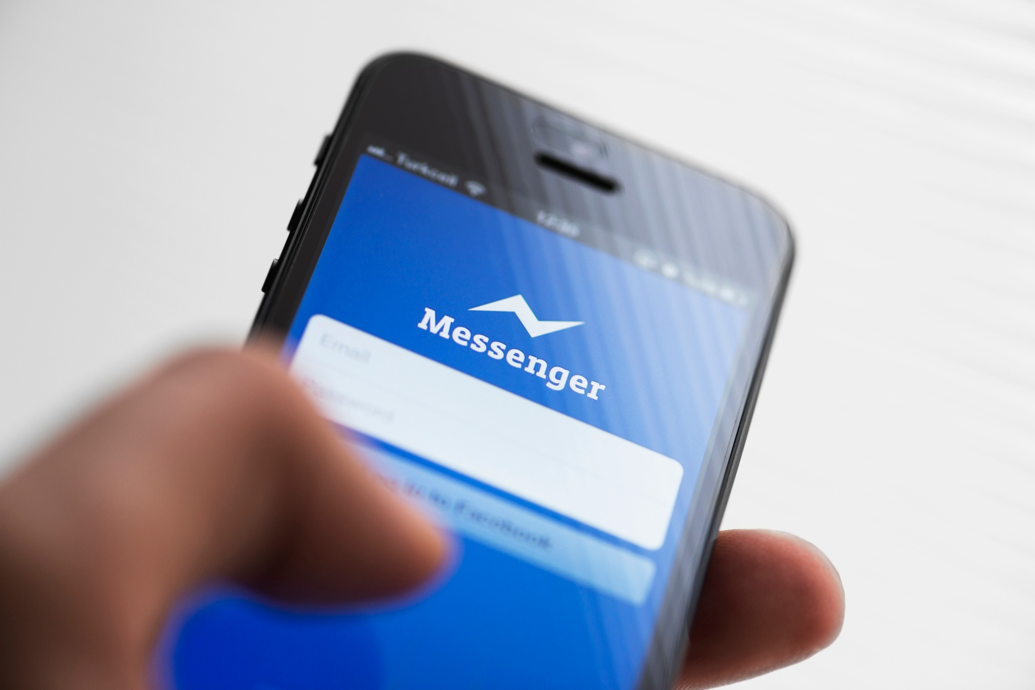 Hand on cellphone- JConnelly blog- What Messenger Apps Mean For Your Business and Why You Shouldn't Ignore Them