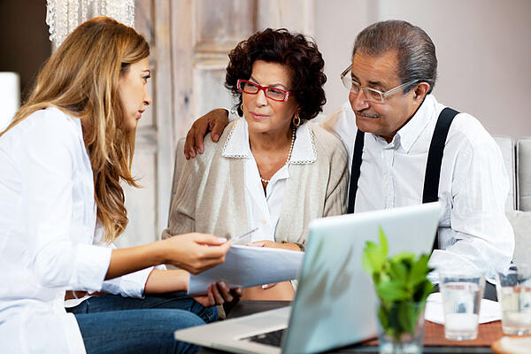 couple with financial advisor - How Financial Advisors Can Help Clients and Media Understand Volatility