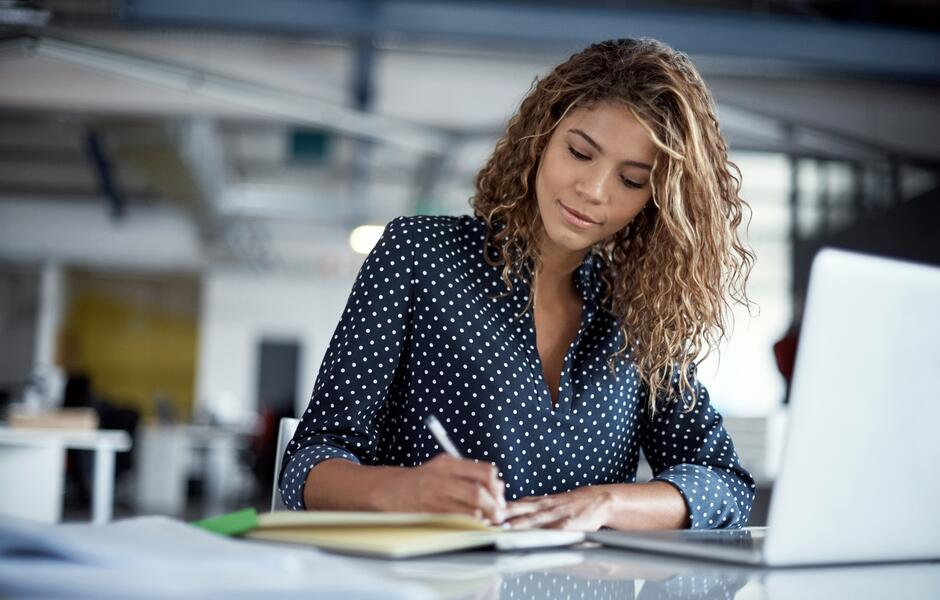 Woman writing- JConnelly gives five tips for crafting a winning pitch