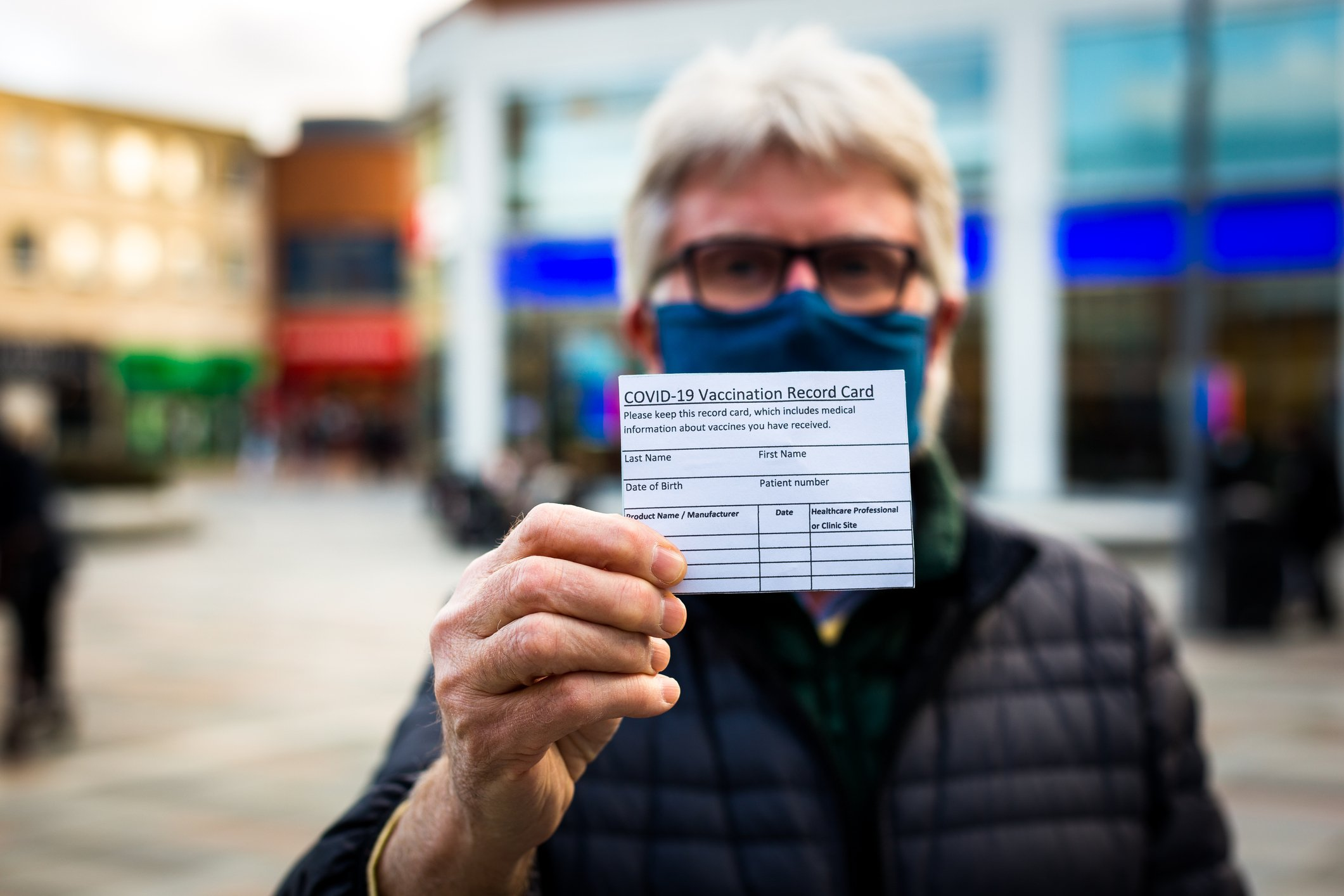 Man Holding Vaccination Card- JConnelly blog- Cause Marketing during Covid