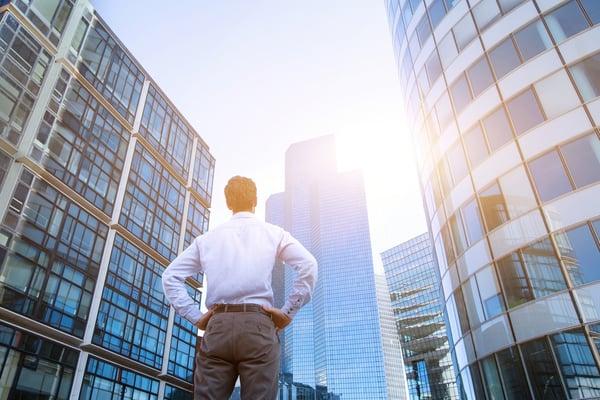 Man staring at buildings- JConnelly blog- 5 Media Tips for Breakaway Advisors
