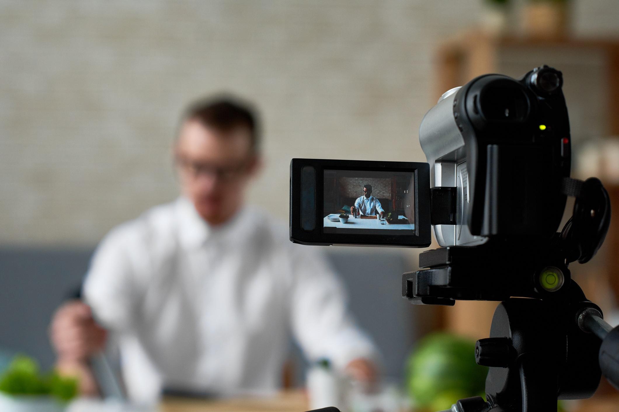 Man taking video. JConnelly blog-Create Thumb-Stopping Videos for Social Media  .jpg
