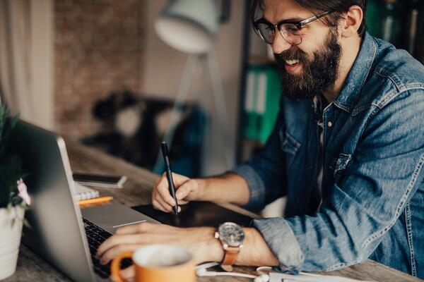 Man typing on laptop- JConnelly blog- 4 Reasons Your Business Should Blog