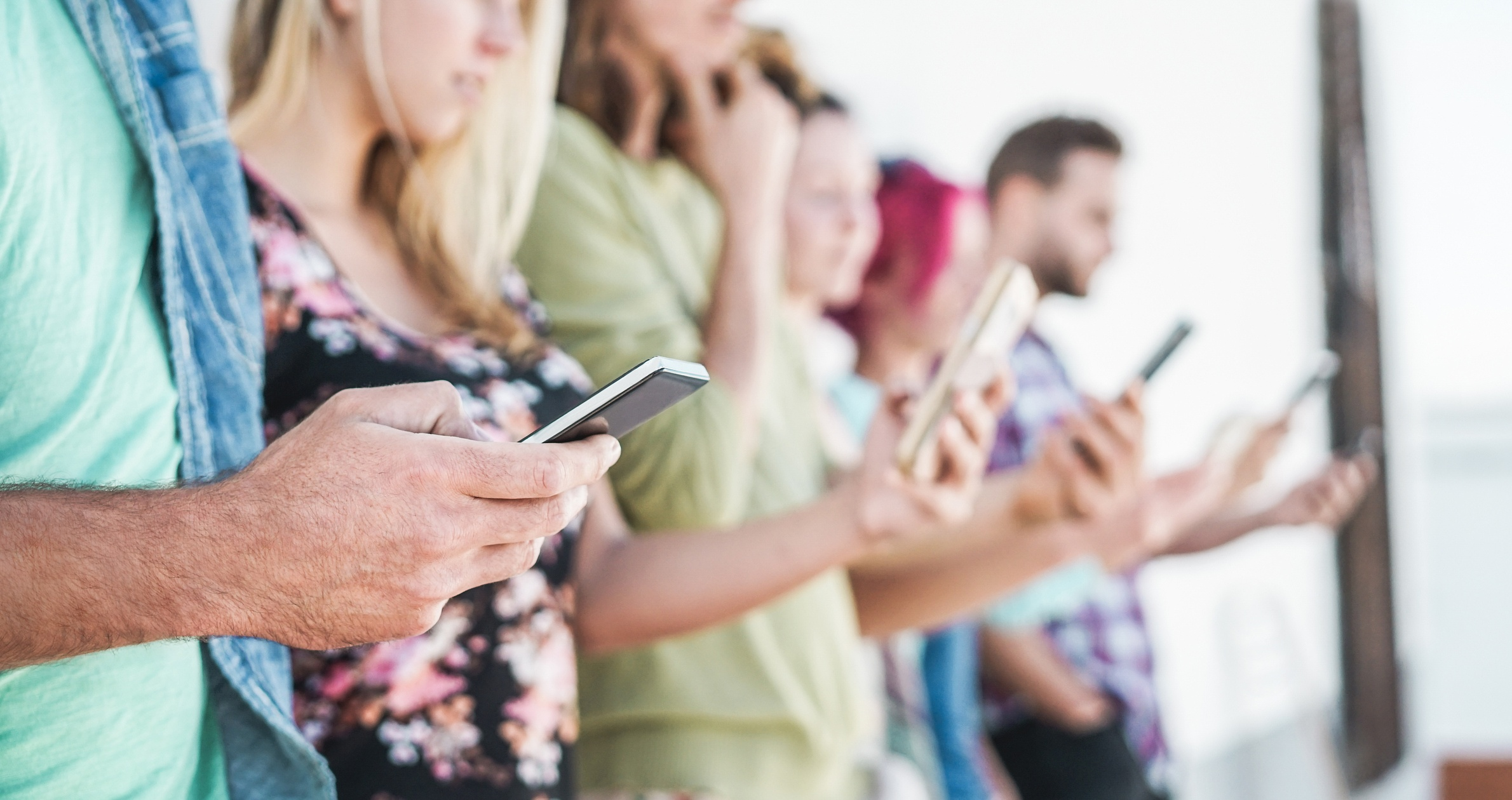 People on mobile- JConnelly blog- How to Use Video in all Stages of the Funnel