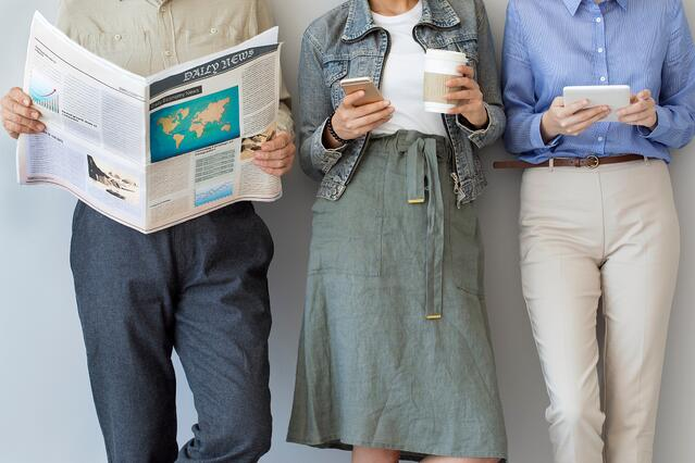 People reading news in a row. Hacks to Consuming Media.jpg