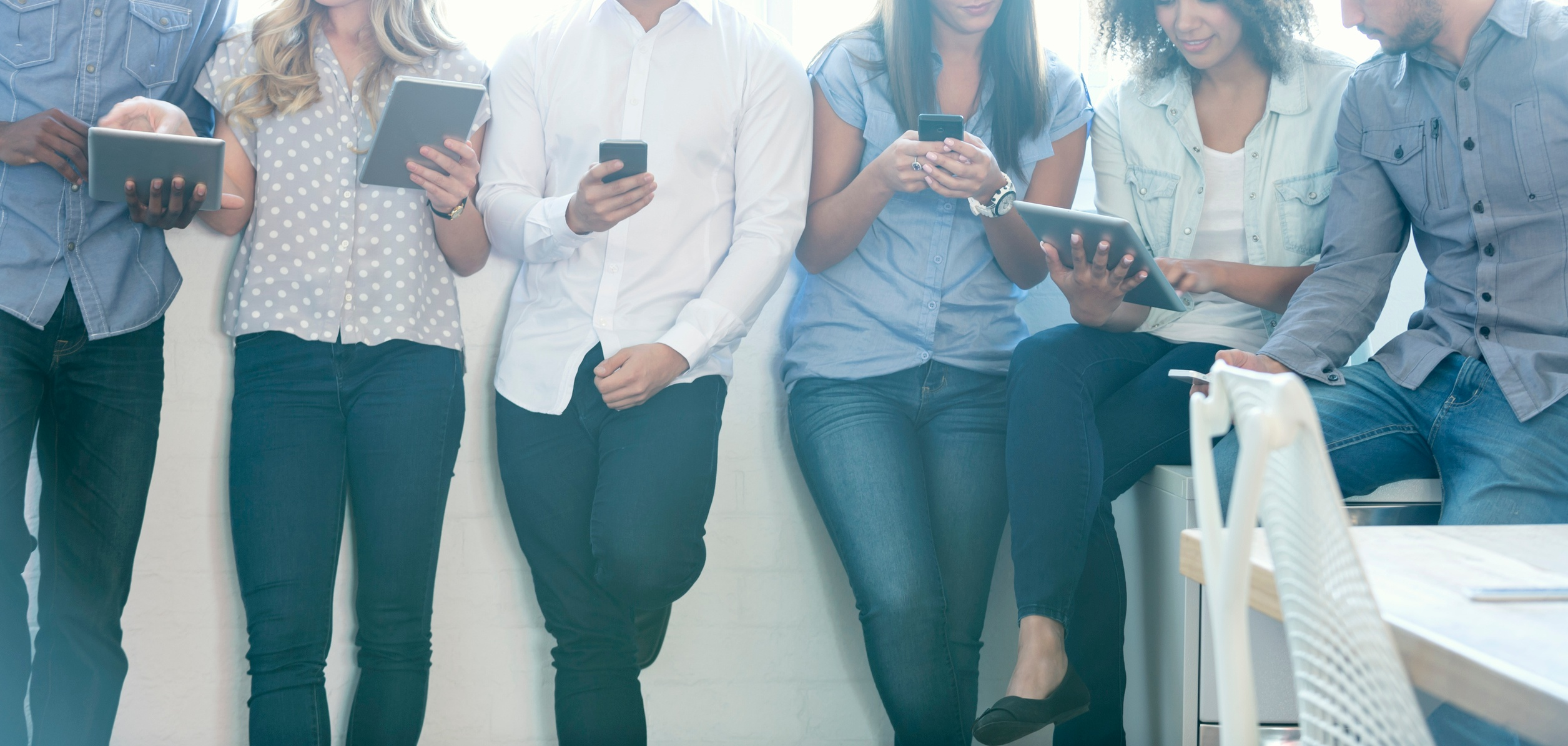 People standing with mobile devices. JConnelly blog- It's Not Easy to Give Up Social Media