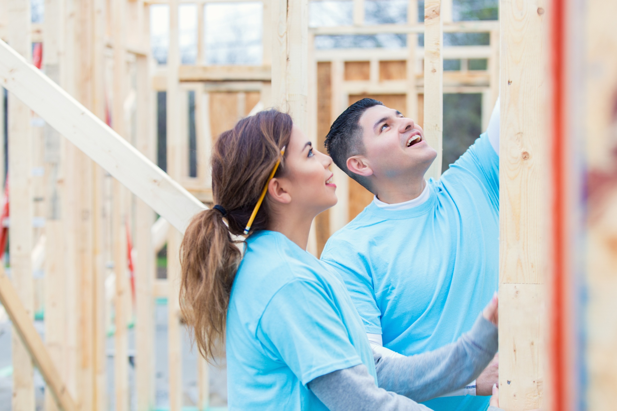 Two people building a home for charity. Philanthropy Is a Part of Who You Are, Not a Quick Way to Build Brand.jpg