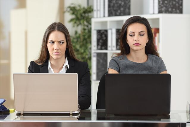 Two women sitting at laptops. There are ways to respond to an insult with dignity and force..jpg