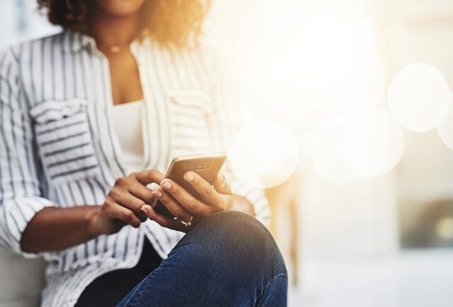 Woman Texting. How to Promote Financial Relationships in a Self-Service Economy- JConnelly blog.jpg