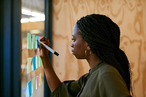 Woman brainstorming ideas- JConnelly blog- Tips for building a content strategy