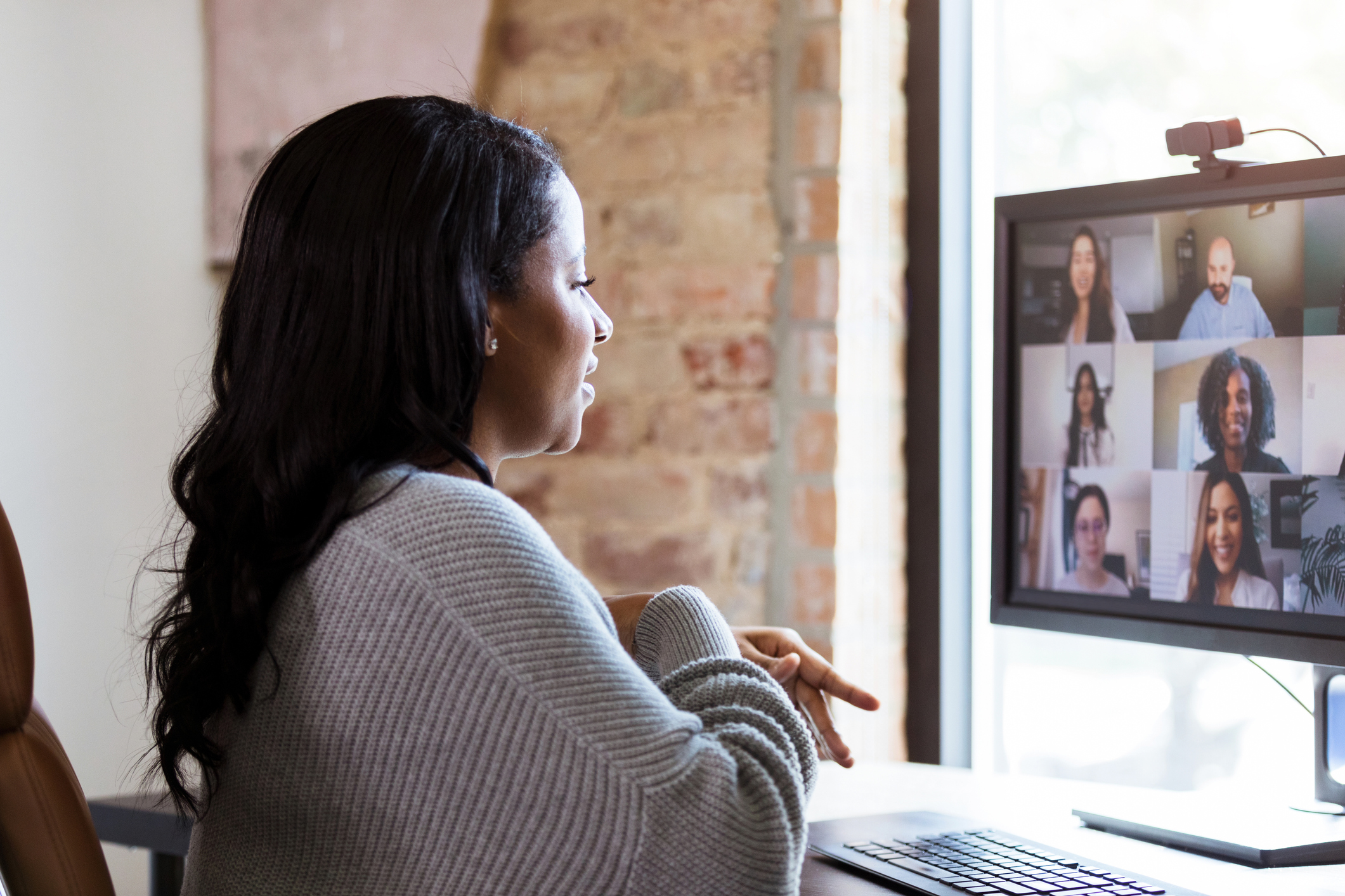 Woman in Virtual Meeting- JConnelly blog- Zoom Best Practices