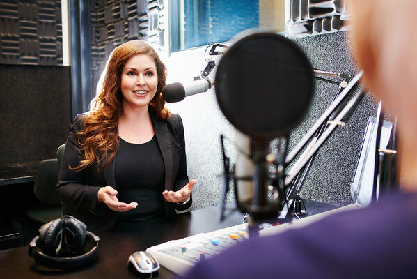 Woman in broadcast interview- JConnelly blog- PR Basics for Financial Firms