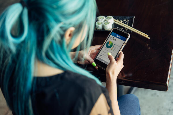 Woman mobile banking- JConnelly blog- PR tips for Financial Brands