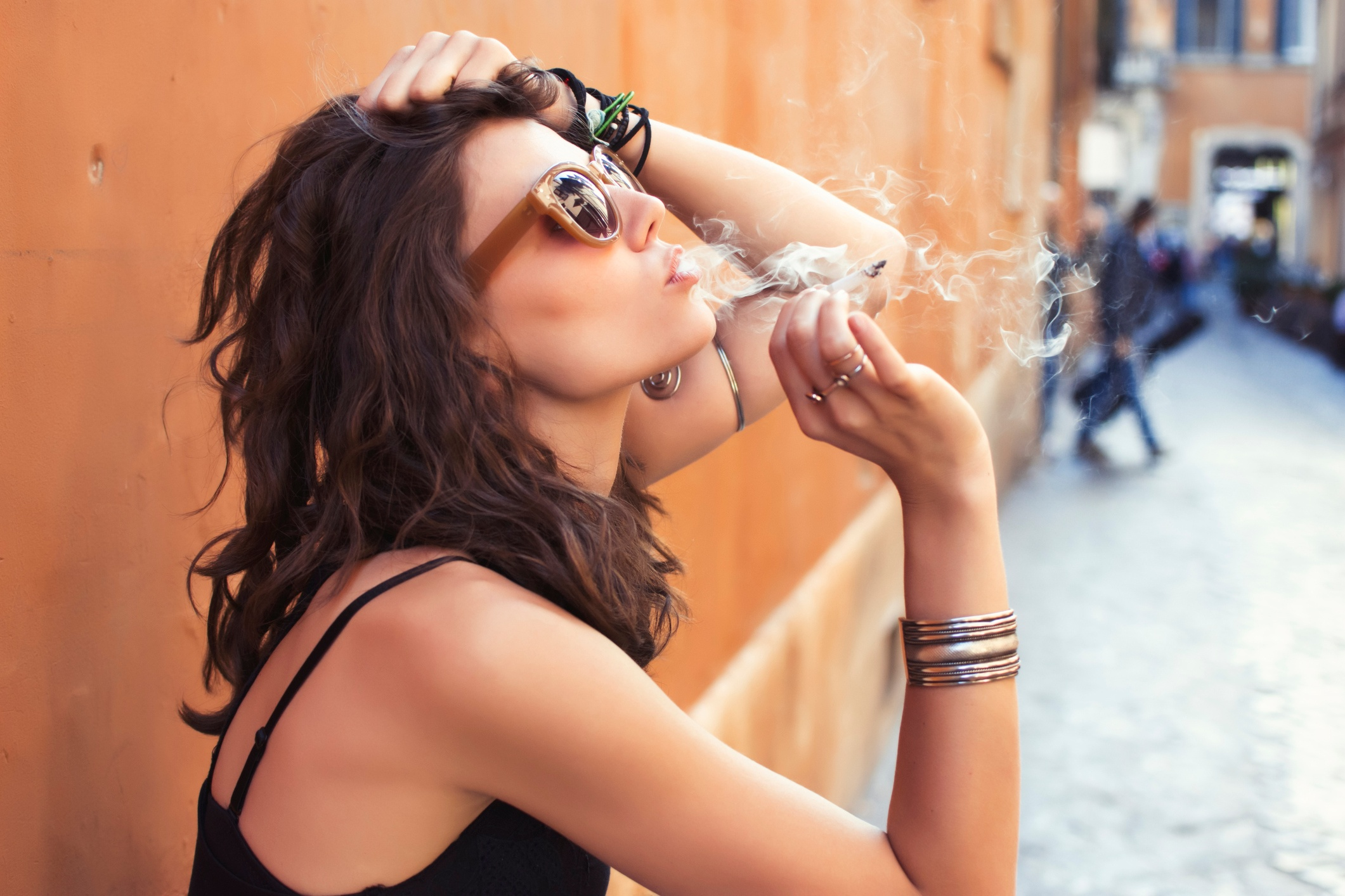 Woman smoking- JConnelly blog-Big Tobacco is Lighting it Up on Social Media and You Can Too